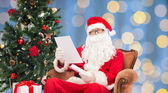 Man in costume of santa claus with letter — Stock Photo