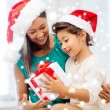 Happy mother and child girl with gift box — Stock Photo #57217977