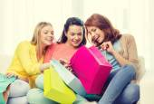 Smiling teenage girls with many shopping bags — Stock Photo