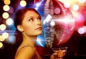Woman with cocktail and disco ball — Stock Photo