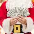 Close up of santa claus with dollar money — Stock Photo #57220225