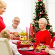 Smiling family having holiday dinner at home — Stock Photo #57222117