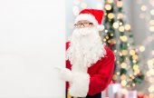 Man in costume of santa claus with billboard — Stock Photo
