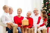 Smiling family with gifts at home — Stock Photo