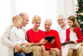 Smiling family with tablet pc computers at home — Foto de Stock