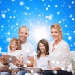 Happy family with tablet pc computers — Stock Photo #57311435