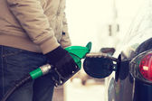 Close up of male refilling car fuel tank — Stock Photo