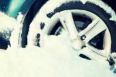Closeup of car wheel stuck in snow — Stock Photo
