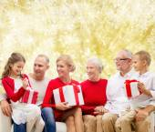Smiling family with gifts — Stock Photo