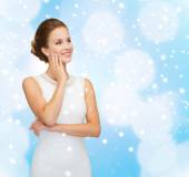 Smiling woman in white dress with diamond ring — Stock Photo