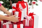 Close up of woman with presents and christmas tree — Foto de Stock