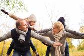 Happy family having fun in autumn park — Stock Photo