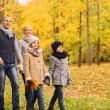 Happy family in autumn park — Stock Photo #57363281