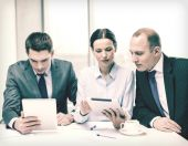 Business team with tablet pc having discussion — Stock Photo
