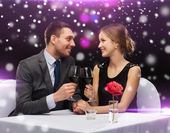Smiling couple at restaurant — Stock Photo