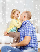Smiling father and daughter hugging at home — Stock Photo