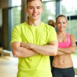 Smiling man and woman in gym — Stock Photo #57400119