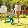 Happy family playing football outdoors — Stock Photo #57401685