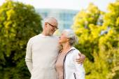 Senior couple hugging in city park — Stock Photo