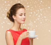 Smiling woman in red dress with cup of coffee — Stock Photo