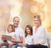 Happy family with tablet pc computers — Stock Photo