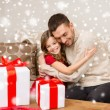Smiling father and girl with gift boxes hugging — Photo #57552409