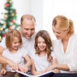 Happy family with book at home — Stock Photo #57554659
