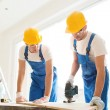 Group of builders with tools indoors — Stock Photo #57557283