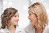 Happy mother and daughter talking — Stock Photo
