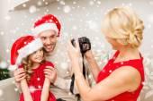Happy family with digital camera taking photo — Stock Photo