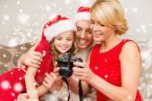 Happy family with digital camera at home — Stock Photo
