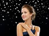 Smiling woman in evening dress — Stock Photo