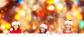 Women in santa helper hat with blank white board — Stock Photo