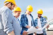 Group of builders with tablet pc and blueprint — Stock Photo