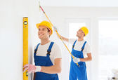 Group of builders with tools indoors — Stock Photo