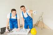 Group of builders with blueprint — Stock Photo