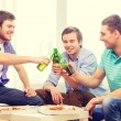 Smiling friends with beer and pizza hanging out — Stock Photo #57759681