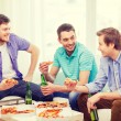 Smiling friends with beer and pizza hanging out — Stock Photo #57759713