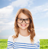 Smiling cute little girl with black eyeglasses — Stock fotografie