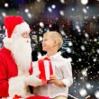 Smiling little boy with santa claus and gifts — Stock Photo #57772081