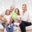 Smiling parents and two little girls at new home — Stock Photo #57856691