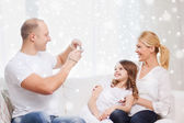 Happy family with camera taking picture at home — Stok fotoğraf