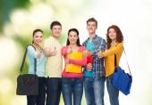 Group of smiling teenagers showing thumbs up — Stock Photo