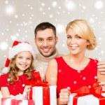 Smiling family holding many gift boxes — Stock Photo #57942467