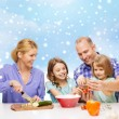 Happy family with two kids making dinner at home — Stock Photo #57942925