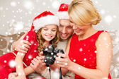 Happy family with digital camera at home — Foto Stock