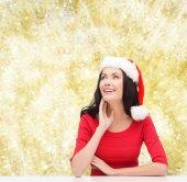 Leende kvinna i santa helper hatt — Stockfoto