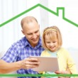 Happy father and daughter with tablet pc computer — Stock Photo #57950635