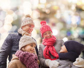 Happy family in winter clothes outdoors — Stock Photo