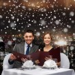 Smiling couple with menus at restaurant — Stock Photo #58109183